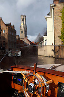 """BRUGES, BELGIUM - FEBRUARY 08 : A detail of a ship's wheel with the canal and the """"Befroi"""" (Belfort) in the background on February 08, 2009 in Bruges, West Flanders, Belgium. (Photo by Manuel Cohen)"""