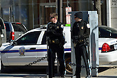 January 30, 2012  (Washington, DC)  Two U.S. Park Police officers observe the OccupyDC protestors gathered at McPherson Square.  Police did not evict the protestors by the noon deadline imposed by the National Park Service.  (Photo by Don Baxter/Media Images International)