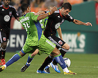 Chris Pontius #13 of D.C. United  breaks past Tyrone Marshall #14 of Seattle Sounders FC during an MLS match at RFK Stadium on July 15 2010, in Washington DC.Seattle won 1-0.