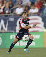 New England Revolution defender Chris Tierney (8) passes the ball.  In a Major League Soccer (MLS) match, Toronto FC (white/red) defeated the New England Revolution (blue), 1-0, at Gillette Stadium on August 4, 2013.