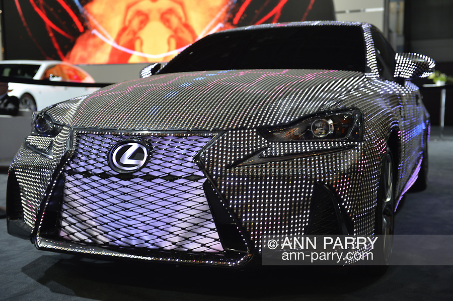 """Manhattan, New York, USA. April 12, 2017.  Lexus LIT IS 2017 sedan - covered with 41,999 RBG LED light units programmable to create changing patterns and colors - is on display at the New York International Auto Show, NYIAS, during the first Press Day at the Javits Center. The car had appeared during New York Fashion Week and is featured in UK artist Dua Lipa's music video for her song """"Be the One."""""""