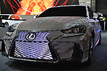 "Manhattan, New York, USA. April 12, 2017.  Lexus LIT IS 2017 sedan - covered with 41,999 RBG LED light units programmable to create changing patterns and colors - is on display at the New York International Auto Show, NYIAS, during the first Press Day at the Javits Center. The car had appeared during New York Fashion Week and is featured in UK artist Dua Lipa's music video for her song ""Be the One."""