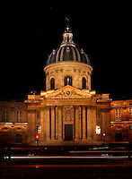 The Institut de France, 1660, Le Vau, Quai de Conti, Paris 6th arrondissement, France. Seen at night from the Pont des Arts. Founded in 1795 by the Directory and replaced the five learned societies : French Academy, the Academie Royale de Peinture et de Sculpture, the Academie Royale des Inscriptions et Medailles, the Académie royale des Sciences and the Academie royale d'Architecture, the Institut de France was reorganized several times between 1795 and 1832 but it was finally restored as a fifth academy : the French Academy, the Academie des Inscriptions et Belles-Lettres (history and archaeology), the Academie des Sciences, the Academie des Beaux-Arts and the Academie des Sciences morales et politiques.