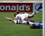 Mia Hamm (9) jumps on Abby Wambach, while Kyle Bivens (4) lays face down nearby, after Abby scored the winning goal at Torero Stadium in San Diego, CA on 8/24/03 after the WUSA's Founders Cup III between the Atlanta Beat and Washington Freedom. The Freedom won 2-1 in overtime.