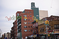 An illuminated sign over Fulton Street in the Bedford-Stuyvesant neighborhood of Brooklyn in New York welcomes shoppers to the Business Improvement District on Saturday, November 29, 2014.  (© Richard B. Levine)