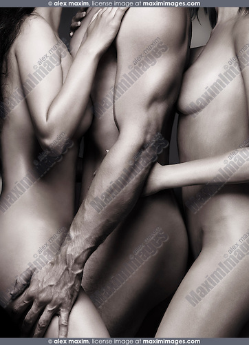 Two nude women leaning against a muscular man, love triangle concept, black and white