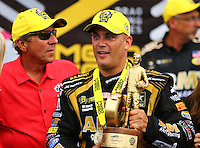 Sep 5, 2016; Clermont, IN, USA; NHRA top fuel driver Tony Schumacher (right) celebrates with father and team owner Don Schumacher after winning the US Nationals at Lucas Oil Raceway. Mandatory Credit: Mark J. Rebilas-USA TODAY Sports