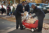 Salvation Army Bandmaster Henry Kissaka, left, conducts efforts to pack away the brass instruments after marching in the 66th Annual Raleigh Christmas Parade, Sat., Nov. 20, 2010.