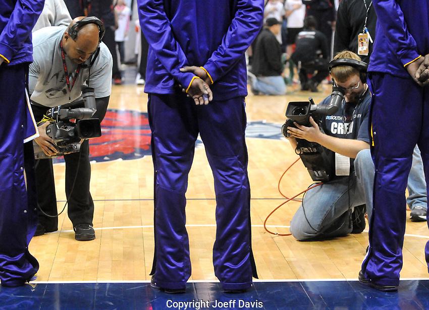 Cameramen shoot Laker superstar Kobe Bryant during the Star-Spangled Banner at Phillips Arena in Atlanta, Georgia before the Los Angeles Lakers vs Atlanta Hawks game Tuesday, March 8, 2011.