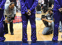 Cameramen shoot Laker superstar Kobe Bryant during the Star-Spangled Banner at Phillips Arena in Atlanta, Georgia before the Los Angeles Lakers vs Atlanta Hawks game Tuesday, March 8, 2011.