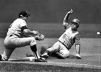 Oakland Athletics Sal Bando slides safe into 3rd base in the 5th inning, Minnesota Twins Harmon Killebrew takes the throw. (1969 photo/Ron Riesterer)