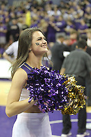 February 12, 2014:   Washington cheer member Kristina Koumaeva entertained fans during a timeout against Stanford.  Washington defeated Stanford 64-60 at Alaska Airlines Arena in Seattle, Washington.