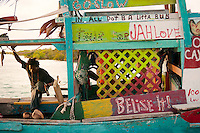 Caye Caulker, Belize, April 2012. Sunset at the beach bar on the Split. Enjoy the beach sand and Caribbean Sea, explore the underwater wonders, try the tasty seafood specials, or experience the laid-back island life. With a population of approximately 1,200 people, the island appeals to visitors looking for a comfortable place to sleep, a white sandy beach, clear aquamarine waters, a variety of bird life, and friendly people. Spend the day snorkeling, fishing, diving, or laying peacefully in your own hammock. In contrast to many other bustling destinations, Caye Caulker has managed to maintain its cozy island appeal.Photo by Frits Meyst/Adventure4ever.com