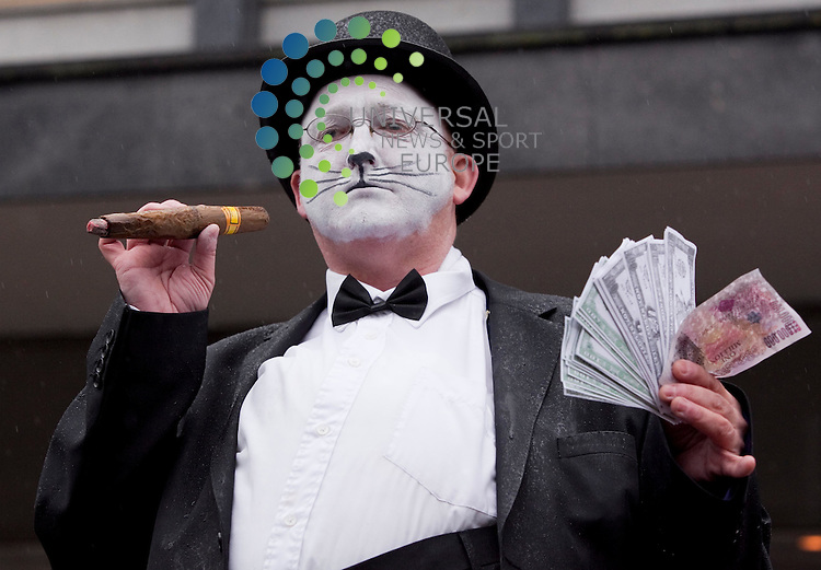 Malcolm Burns( unison) dresses as a fat cat banker to send the message that the bankers should tighten their belts not the public in Argyle st Glasgow .Johnny Mclauchlan/Universal News and Sport (Scotland) 29/09/2010