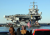 Sailors man the rails aboard the aircraft carrier USS Enterprise (CVN 65) while family and friends wave goodbye as the ship departs from Naval Station Norfolk, Thursday, January 13, 2011. Enterprise is deploying as part of the Commander, Carrier Strike Group (CCSG) 12 in support of maritime security operations and theater security cooperation efforts in the U.S. 5th and 6th Fleet areas of responsibility. .Mandatory Credit: Eric Garst - U.S. Navy via CNP