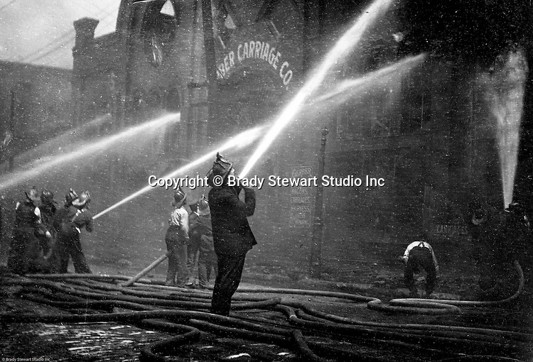 Pittsburgh PA:  View of Pittsburgh firefighters fighting a fire at a Carriage factory -1905