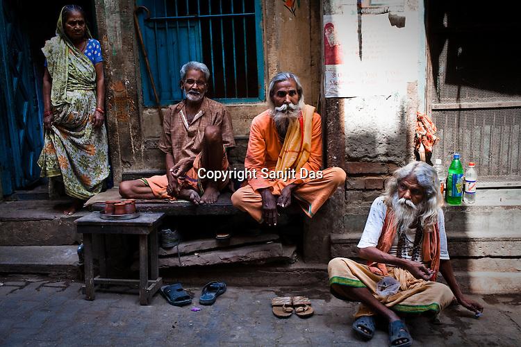 Sadhus (holy man) seen outside the Gauri Kedareshwar temple in the ancient city of Varanasi in Uttar Pradesh, India. Photograph: Sanjit Das/Panos