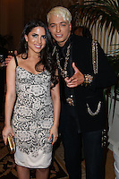 BEVERLY HILLS, CA, USA - MARCH 28: Caren Brooks, KUBA Ka at the Versace Unveiling Of The 1st Pop Recording Artist Superhero - KUBA Ka's Performance Outfits. Designed by the legendary fashion hosuse - Donatella Versace. For the Benefit of the Face Forward Foundation (Plastic Surgery for Destroyed Faces from Violence). Pop entertainer TV personality KUBA Ka, together with VERSACE, unveiled Kuba Ka's new Versace images, for the First Pop Artist/Superhero of the World. He has become the inspiration of Donatella's newest and wildest creations and will celebrate the launch of his new power house conglomerate - KUBA Ka Empire Inc. in collaboration with the sensational fashion house - VERSACE on Friday, his birthday at a red carpet media and celebrity event at the luxurious Peninsula Hotel in Beverly Hills held at the Peninsula Hotel on March 28, 2014 in Beverly Hills, California, United States. (Photo by Xavier Collin/Celebrity Monitor)