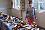Village Hall tea after Well Dressing Bisley Gloucestershire UK 2015. Blue latex  gloves are for health and hygiene reasons.