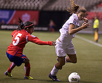 Tobin Heath, right, of the United States gets past Diana Saenz of Costa Rica during play in the CONCACAF Olympic Qualifying semifinal match at BC Place in Vancouver, B.C., Canada Friday Jan. 27, 2012. The United States won the match 3-0 to earn a berth in 2012 London Olympics.