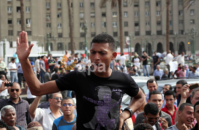 Egyptian protesters attend a demonstration, against presidential candidate Ahmed Shafiq at Tahrir Square in Cairo May 29, 2012. According to full official results released Monday by the election commission. Commission chief Farouq Sultan said in a press conference that the Brotherhood's Mohammed Morsi and Ahmed Shafiq, a former air force commander and a longtime friend of the ousted leader, were the top two finishers in the first round of voting held on May 23-24. Photo by Ashraf Amra