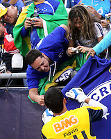 Fans ask Cruzeiro goalkeeper Flavio to sign banners and flags.  Brazil's Cruzeiro beat the New England Revolution, 3-0 in a friendly match at Gillette Stadium on June 13, 2010
