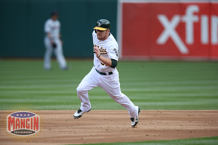 OAKLAND, CA - APRIL 2:  Brandon Moss #37 of the Oakland Athletics runs the bases against the Cleveland Indians during the game at O.co Coliseum on Wednesday, April 2, 2014 in Oakland, California. Photo by Brad Mangin
