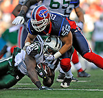 2 November 2008:  New York Jets' running back Thomas Jones (20) is tackled by Buffalo Bills linebacker Keith Ellison (56) at Ralph Wilson Stadium in Orchard Park, NY. The Jets defeated the Bills 26-17 improving their record to 5 and 3 for the season...Mandatory Photo Credit: Ed Wolfstein Photo