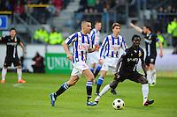 VOETBAL: HEERENVEEN: Abe Lenstra Stadion, SC Heerenveen - Vitesse, 21-01-2012, Oussama Assaidi (#22), Anthony Annan (#20), Eindstand 1-1, ©foto Martin de Jong