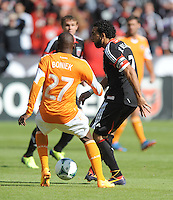 Dwayne De Rosario (7) of D.C. United goes against Boniek Garcia (27) of the Houston Dynamo. The Houston Dynamo defeated D.C. United 2-1, at RFK Stadium, Saturday October 27, 2013.