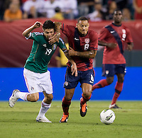 Jermaine Jones (8) of the USMNT fights for the ball with Oribe Peralta (19) of Mexico during the game at Lincoln Financial Field in Philadelphia, PA. The USMNT tied Mexico, 1-1.