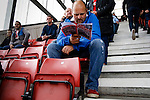Stoke City 1 West Bromwich Albion 1, 24/09/2016. Bet365 Stadium, Premier League. Stoke fan reading the club fanzine The Oatcake. Photo by Paul Thompson.
