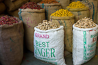 Red chillies, turmeric and ginger root on sale at Khari Baoli spice and dried foods market, Old Delhi, India