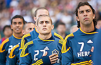 CARSON, CA – July 4, 2011: LA Galaxy midfielder Bryan Jordan (27) and Jovan Kirovski (7) during the National Anthem before the match between LA Galaxy and Seattle Sounders FC at the Home Depot Center in Carson, California. Final score LA Galaxy 0, Seattle Sounders FC 0.