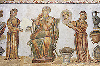 5th century Roman mosaic panel of the ceremonial dressing of a lady. The lady was of the landed gentry from inland Carthage. She is sitting on a high backed armchair and is surrounded by two ornatrix, maids, whoa re helping her to apply make up and style her hair. Items related to bathing and grooming are depicted on the background of the mosaic. The maid hold a mirror for the lady in which we see her reflection The scene is an allegory of the myth of &lsquo;Venus at her toilet&rsquo;.<br /> <br /> From the floor of the changing room of the private baths of the Sidi Ghraib villa, Borj El Amre region, Tunisia. The Bardo Museum, Tunis, Tunisia.