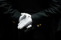 29 December 2005 - New York City, NY - A recruit belonging to the New York Police Department's Class of 2005 holds his hands together behind his back during the graduation ceremony, 29 December 2005, New York City. 1,735 recruits were sworn in during the ceremony.