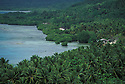Palm trees, coast and Truk Lagoon from Xavier High School viewpoint; Weno Island, Chuuk, Micronesia.
