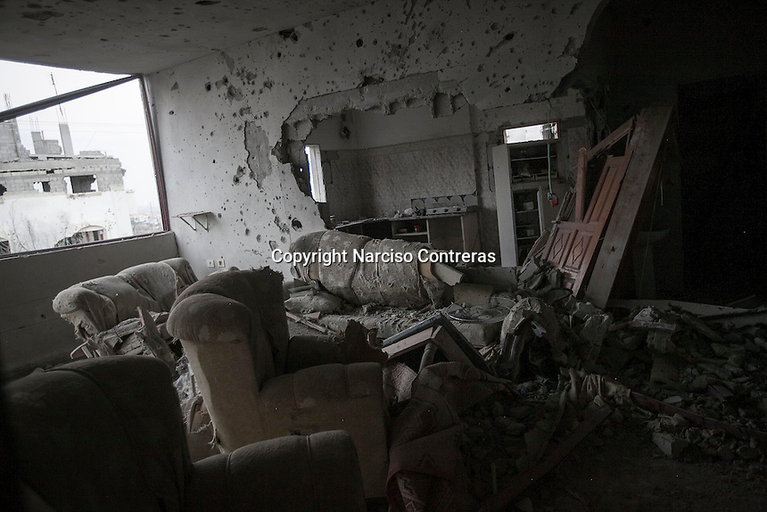 "n this Sunday, Aug. 17, 2014 photo, an apartment destroyed by heavy artillery is seen in Shuyaja neighborhood after it was hit during the ""Protective Edge"" Israeli military operation in Gaza Strip. (Photo/Narciso Contreras)"