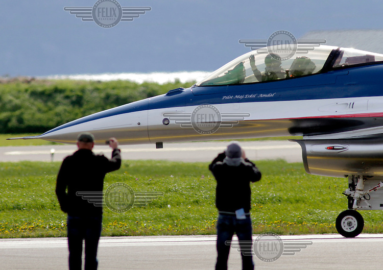 Norwegian F-16 piloted by Eskild Amdal gets greetings from the crowd after performing a display during Tiger Air show.  Nato Tiger Meet is an annual gathering of squadrons using the tiger as their mascot. While originally mostly a social event it is now a full military exercise. Tiger Meet 2012 was held at the Norwegian air base Ørlandet.