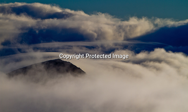 Clouds at sunrise atop 10,023 foot Haleakala Volcano Crater in the middle of the Pacific Ocean in Haleakala National Park on the Island of Maui, Hawaii. - Photo by Jim Urquhart/Straylighteffect.com<br /> 11/17/2009