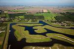 Nederland, Groningen, Oldambt, 08-09-2009; Blauwestad, nieuw aangelegd woongebied inclusief recreatiegebied. De nog niet bebouwde schiereilanden van  de wijk 'Het Riet', omgeven door de dorpen Oostwold en Finsterwolde (r). Het lege platteland met aan de horizon de Eems en Dollard. Het project Blauwe Stad is bedoelt om de economisch achtergebleven regio van Noordoost Groningen een impuls te geven.  .Blauwestad (Blue City) newly constructed residential area, including recreational lake. The old country seen to the Eems and Dollard. The Blue City project is meant to give a boost to the  economically backward region of northeast Groningen. .luchtfoto (toeslag); aerial photo (additional fee required); .foto Siebe Swart / photo Siebe Swart