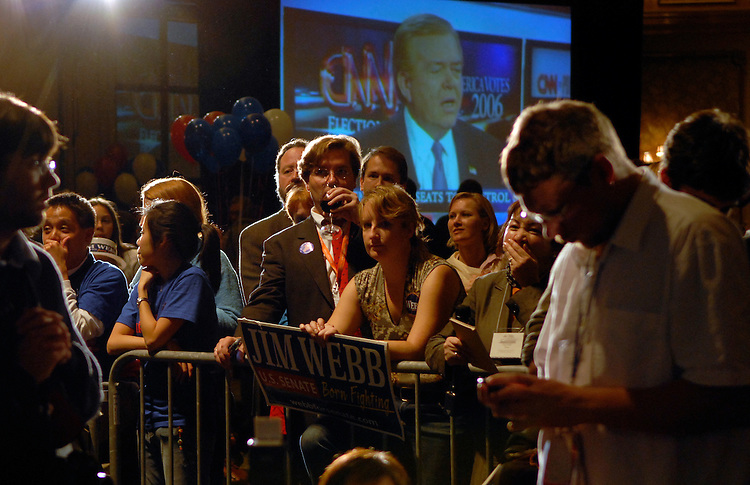 Webb supporters wait and watch the latest results showing Democratic U.S. Senate candidate Jim Webb is up by a small amount of votes during an election nigth party November 7, 2006 in Vienna, Virginia.