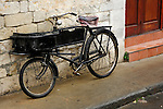 Stock photo of an Old bicycle leaning against a stone wall of an old building Horizontal Cyprus Limassol street