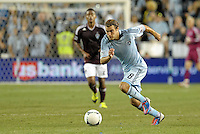 Sporting midfielder Graham Zusi (8) drives at the Rapids goal..Sporting Kansas City defeated Colorado Rapids 2-0 in Open Cup play at LIVESTRONG Sporting Park, Kansas City, Kansas.