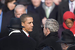 President Barack Obama speaks to his predecessor, President George W. Bush, after taking the oath of office at The Capitol Building. Washington, DC, January 20, 2009.