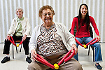 An Occupational Therapy student laughs with seniors during a pilates class at the Medford Senior Center. (Alonso Nichols/Tufts University)