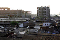 Tower blocks can be seen being built within the slum on 21st Oct 2006. Dharavi is now seen as prime real estate and developers are slowly moving into the slum.