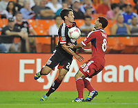 Lewis Neil (24) of D.C. United goes against Dilly Duka (8) of the Chicago Fire.  The Chicago Fire defeated D.C. Untied 3-0, at RFK Stadium, Friday October 4 , 2013.