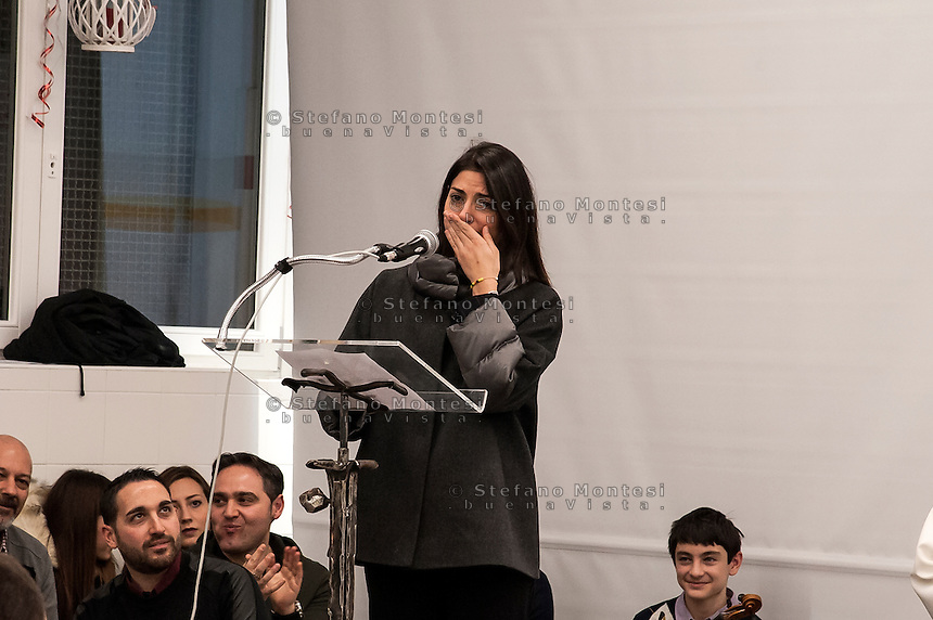 """ROME, ITALY -  DECEMBER 24:  Rome Mayor Virgina Raggi  recoils  and crying  during  a speech held during  Christmas Mass at the hostel """"Don Luigi Di Liegro"""" to Termini Station, with the  guests of Caritas on December 24, 2016 in Rome, Italy. (Photo by Stefano Montesi/Corbis via Getty Images)"""