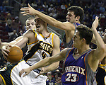 Phoenix Suns Seattle SuperSonics Nick Collison battles  three  Phoenix Suns defenders in the first half of their preseason game on Saturday, Oct. 16, 2004 in Seattle.  Jim Bryant Photo. &copy;2010. All Rights Reserved.